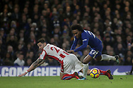 Geoff Cameron of Stoke City fouls Willianof Chelsea © in the box and a penalty is given.<br /> Premier league match, Chelsea v Stoke city at Stamford Bridge in London on Saturday 30th December 2017.<br /> pic by Kieran Clarke, Andrew Orchard sports photography.