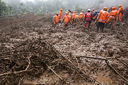 February 6, 2018 - Bogor, Bogor, Indonesia - Team from Indonesia search and rescue still on going process finding victim from landslide at Puncak Bogor, also firefighter try to clean the remaining mud from the landslide with excavator. Landslide hit puncak-bogor due to heavy rain that hit the area in couples days and also by deforestation for villa at the location. (Credit Image: © Donal Husni via ZUMA Wire)