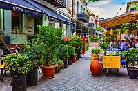 Tbilisi , Georgia - August 25, 2019 :  Tourist people enjoying restaurant in a street of the old town landmark of Tbilisi Georgia capital city eastern Europe