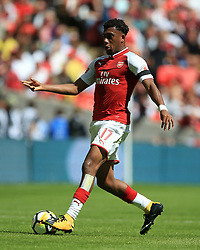"""Arsenal's Alex Iwobi during the Community Shield at Wembley, London. PRESS ASSOCIATION Photo. Picture date: Sunday August 6, 2017. See PA story SOCCER Community Shield. Photo credit should read: Nigel French/PA Wire. RESTRICTIONS: EDITORIAL USE ONLY No use with unauthorised audio, video, data, fixture lists, club/league logos or """"live"""" services. Online in-match use limited to 75 images, no video emulation. No use in betting, games or single club/league/player publications."""