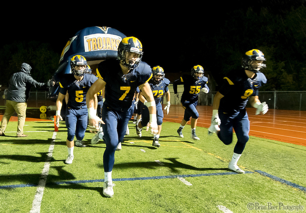 The Oak Ridge Trojans come on the to the field before the game as the Oak Ridge High School Trojans host the Granite Bay Grizzlies, Friday Oct 14, 2016.<br /> photo by Brian Baer
