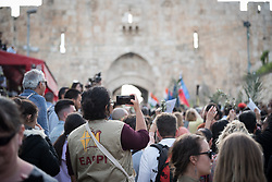 14 April 2019, Jerusalem: Ecumenical Accompanier at work. On Palm Sunday, thousands gathered and marched from the Mount of Olives down to the Old City of Jerusalem, following in the footsteps of Jesus, as he journeyed to Jerusalem.