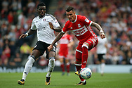 Marvin Johnson of Middlesbrough (R) fends off Sheyi Ojo of Fulham (L). EFL Skybet championship match, Fulham v Middlesbrough at Craven Cottage in London on Saturday 23rd September 2017<br /> pic by Steffan Bowen, Andrew Orchard sports photography.