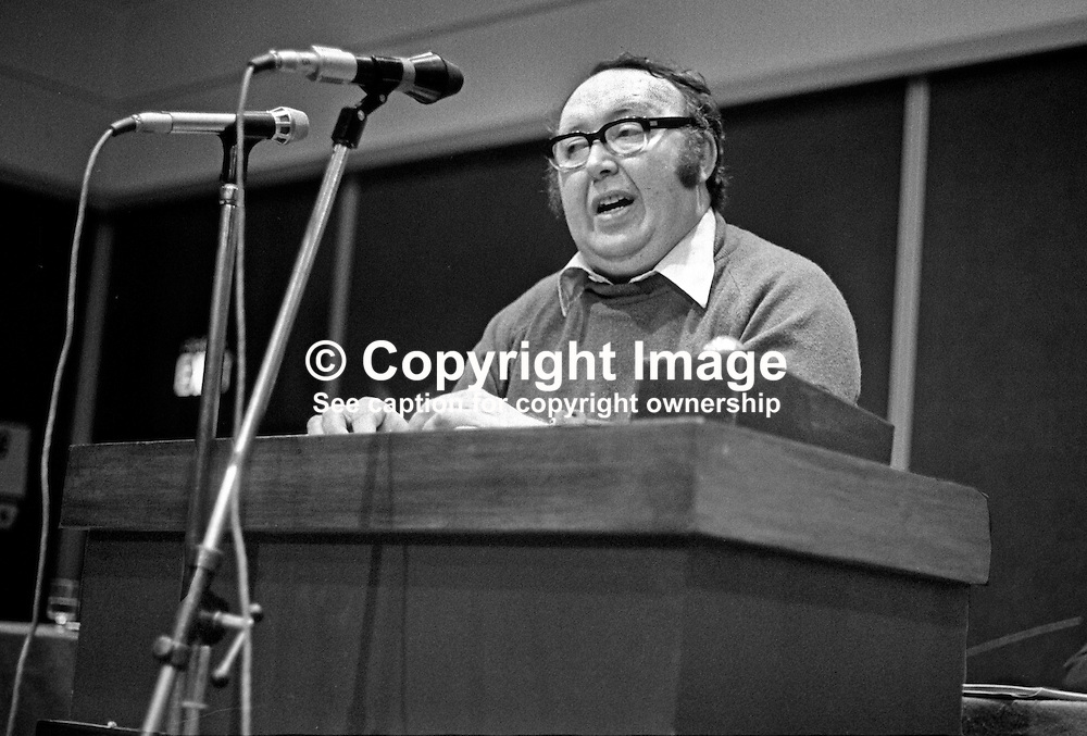 Paddy Devlin, SDLP, Social Democratic & Labour Party, N Ireland, UK, speaking at his party's annual conference, Europa Hotel, Belfast, 197501000098PD1.<br /> <br /> Copyright Image from Victor Patterson, Belfast, UK<br /> <br /> t: +44 28 9066 1296 (from Rep of Ireland 048 9066 1296)<br /> m: +44 7802 353836<br /> e: victorpattersonbelfast@gmail.com<br /> <br /> www.images4media.com<br /> <br /> Please see my full Terms and Conditions of Use at https://www.images4media.com/p/terms-conditions - it is IMPORTANT that you familiarise yourself with them.<br /> <br /> Images used online incur an additional cost. This cost should be agreed in writing in advance. Online images must be visibly watermarked i.e. © Victor Patterson or that of the named photographer within the body of the image. The original metadata must not be deleted from images used online.<br /> <br /> This image is only available for the use of the download recipient i.e. television station, newspaper, magazine, book publisher, etc, and must not be passed on to a third party. It is also downloaded on condition that each and every usage is notified within 7 days to victorpattersonbelfast@gmail.com.<br /> <br /> The right of Victor Patterson (or the named photographer) to be identified as the author is asserted in accordance with The Copyright Designs And Patents Act (1988). All moral rights are asserted.