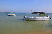 Tourist boat moored on beach Pasikudah Bay, Eastern Province, Sri Lanka, Asia