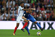 Raheem Sterling of England challenges Jan Durica of Slovakia ®.  FIFA World cup qualifying match, European group F, England v Slovakia at Wembley Stadium in London on Monday 4th September 2017.<br /> pic by Andrew Orchard, Andrew Orchard sports photography.