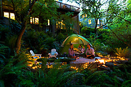A Family in Portland, Oregon camping and making s'mores in the back yard in response to Covid-19