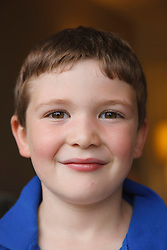 Portrait of white boy smiling