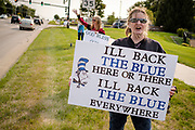 """19 SEPTEMBER 2020 - ALTOONA, IOWA: Pro-police demonstrators line 8th Ave, near the police station in Altoona, a suburb of Des Moines. About 30 people attended an """"Uplifting Our Police"""" rally to show support for not just Altoona police, but law enforcement across the country.      PHOTO BY JACK KURTZ"""