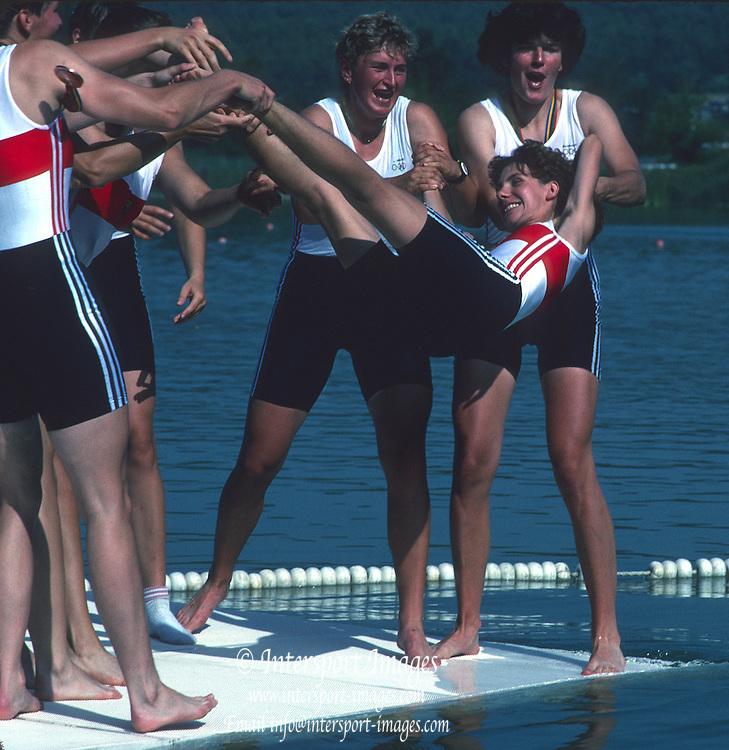 Banyoles, SPAIN, German Women's Eight, GER W8+. Throwing in the cox, celebrating winning the Bronze medal. Crew: Sylvia DOERDELMANN: Kathrin Christiane HARZENDORF: Cerstin PETERSMANN , Dana PYRITZ : Ute SCHELL - STANGE: Annegret STRAUCH: Judith UNGEMACH - ZEIDLER:  cox, Daniela NEUNAST.  1992 Olympic Regatta, Lake Banyoles, Barcelona, SPAIN.    [Mandatory Credit: Peter Spurrier: Intersport Images]