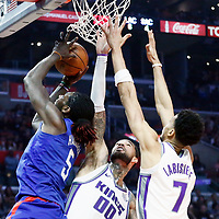 13 January 2018: LA Clippers forward Montrezl Harrell (5) goes for the layup past Sacramento Kings center Willie Cauley-Stein (00) and Sacramento Kings forward Skal Labissiere (7) during the LA Clippers 126-105 victory over the Sacramento Kings, at the Staples Center, Los Angeles, California, USA.