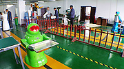 "HARBIN, CHINA - JUNE 07: (CHINA OUT) <br /> <br />  A robot tries delivering meals on June 7, 2015 in Harbin, Heilongjiang province of China. A Haiying robot manufacturer in north China\'s Harbin Harbin Economic and Technological Development Zone has developed into a comprehensive company where multifunctional robots could be made out to work on the land, in water and air. Liu Hasheng, chief manager and founder of the robot manufacturer, opened the first conprehensive robots restaurant in China with ""waiters\"" produced by his own company. According to Liu Hasheng, those robot waiters have been sold out throught out country and his orders has also a great business opportunity in the future.<br /> ©Exclusivepix Media"