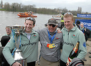 Putney, London,   Left - Deaglan MCEACHERN, President CUBC, Centre - Chris NILSSON, Chief Coach, CUBC, Right - Fred GILL, Stroke, CUBC, celebrating, 156th University Boat Race, River Thames, between Putney and Chiswick, on the Championship Course.  Saturday  03/04/2010 [Mandatory Credit Karon Phillips/Intersport Images]