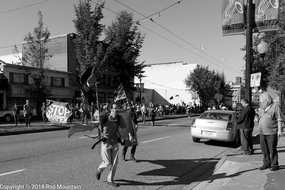 """Crossing the street, protesters have their eye on a Chevron Gas Station for the """"Party Against the Pipelines"""" Protest in Vancouver, B.C. Photo: © Rod Mountain"""