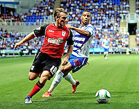 Ipswich Town's Jay Tabb (L) in action against Reading's Hal Robson-Kanu <br /> <br /> FT: Reading 2 - 1 Ipswich Town<br /> <br />  - (Photo by David Horton/CameraSport) - <br /> <br /> Football - The Football League Sky Bet Championship - Reading v Ipswich Town - Saturday 3rd 2013 - Madejski Stadium - Reading<br /> <br /> © CameraSport - 43 Linden Ave. Countesthorpe. Leicester. England. LE8 5PG - Tel: +44 (0) 116 277 4147 - admin@camerasport.com - www.camerasport.com