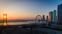 Aerial view of the Ferris wheel at sunset on Bluewaters island in Dubai, UAE.