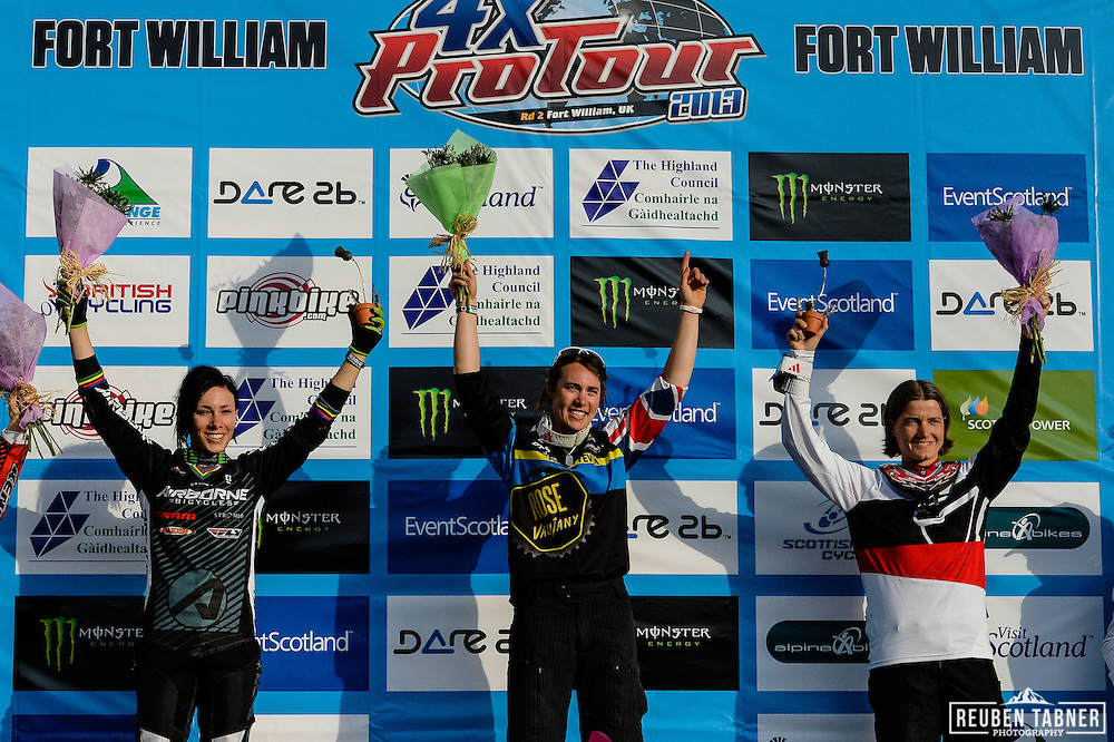 08.06.2013 Fort William, Scotland. The Podium: Katy Curd (1st), Caroline Buchanan (2nd) and Anneke Beerten (3rd) 4X Pro Tour at the UCI Mountain Bike World Cup in Fort William, the First British Female to do so.