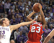 Kansas guard Erica Hallman (R) puts up a shot against pressure from Kansas State guard Kimberly Dietz (L) during the first half of K-State's 69-63 win over the Jayhawks at Bramlage Coliseum in Manhattan, Kansas, January 25, 2006.