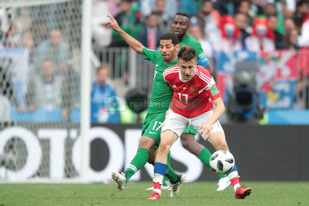 June 14, 2018 - Moscow, Russia - midfielder Taiseer Aljassam of Saudi Arabia National team and midfielder Aleksandr Golovin of Russia National team during the Group A match between Russia and Saudi Arabia at the 2018 soccer World Cup at Luzhniki stadium in Moscow, Russia, Tuesday, June 14, 2018. (Credit Image: © Anatolij Medved/NurPhoto via ZUMA Press)