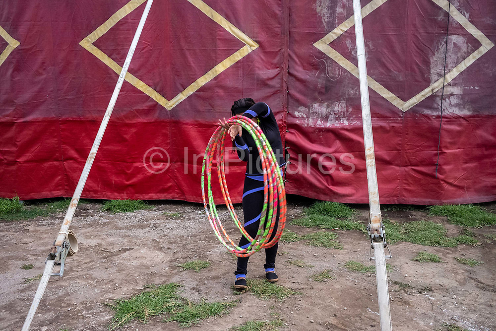 Nayusky, 17, a circus performer, collects her hoops to practice her act at the Circo Hermanos Lopez in Quetzaltenango, Guatemala.