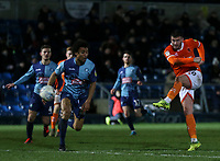 Blackpool's Gary Madine shoots for goal but it went wide with Wycombe Wanderers' Darius Charles close by<br /> <br /> Photographer Lee Parker/CameraSport<br /> <br /> The EFL Sky Bet League One - Wycombe Wanderers v Blackpool - Tuesday 28th January 2020 - Adams Park - Wycombe<br /> <br /> World Copyright © 2020 CameraSport. All rights reserved. 43 Linden Ave. Countesthorpe. Leicester. England. LE8 5PG - Tel: +44 (0) 116 277 4147 - admin@camerasport.com - www.camerasport.com