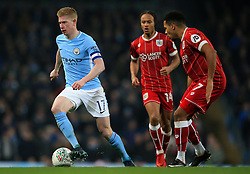 Fabian Delph of Manchester City takes on Korey Smith of Bristol City and Bobby Reid  - Mandatory by-line: Matt McNulty/JMP - 09/01/2018 - FOOTBALL - Etihad Stadium - Manchester, England - Manchester City v Bristol City - Carabao Cup Semi-Final First Leg