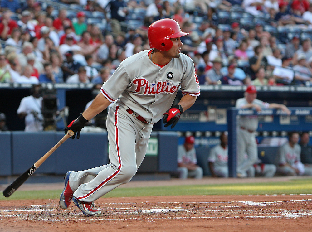 ATLANTA - JUNE 30:  Center fielder Shane Victorino #8 of the Philadelphia Phillies follow through on a swing during the game against the Atlanta Braves at Turner Field on June 30, 2009 in Atlanta, Georgia.  The Braves beat the Phillies 5-4 in 10 innings.  (Photo by Mike Zarrilli/Getty Images)