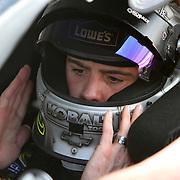 Sprint Cup Series driver Jimmie Johnson (48) sits in his car at Daytona International Speedway on February 18, 2011 in Daytona Beach, Florida. (AP Photo/Alex Menendez)