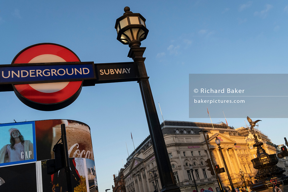 A low-angle view of digital advertising, the Trocadero and the London Underground roundel at Piccadilly Circus in the West End, on 6th November 2020, in London, England.