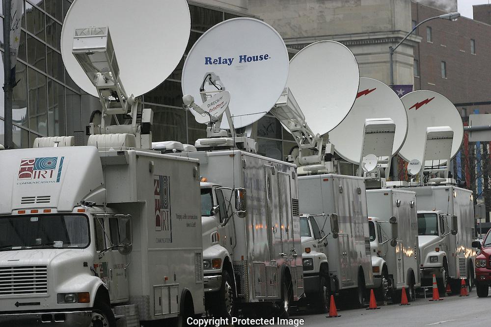 A 19.3 MG IMAGE OF:.Satellite trucks outside of the media center.  Photo by Dennis Brack