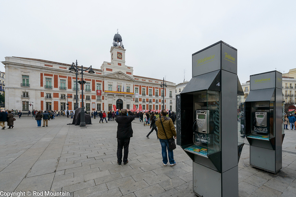 Madrid, Spain - February 15, 2018 - Locals and tourists pass through Puerta del Sol as a Union protest carries on. Dating back to the 15th century, the Puerta del Sol originated as one of the gates of the city. Today it contains a number of well know sights associated with Spain including the Royal House of the Post Office.<br /> <br /> Image: © Rod Mountain <br /> <br /> http://www.rodmountain.com <br /> http://bit.ly/Madrid_bw<br /> Nikon D800 / Nikkor Lens <br /> <br /> @spain @visita_madrid @NikonUSA @nikoncanada @nikoneurope<br /> <br /> @spain.info @visitamadridoficial @NikonUSA @nikoncanada @nikoneurope<br /> <br /> @spain @Visita_Madrid @NikonUSA @nikoncanada @nikoneurope @TurismoMadrid<br /> <br /> https://en.wikipedia.org/wiki/Puerta_del_Sol<br /> https://en.wikipedia.org/wiki/Portal:Madrid<br /> https://www.spain.info/en/<br /> <br /> #VisitMadrid #bnw_madrid #Heritage #Architecture #exploretheglobe #places_wow #worldtravelpics #moodygrams #passionpassport #iglobal_photographers #ig_great_pics #igblacknwhite#bw_lovers #streetactivityteam #streetmobs #streetphotography #urbanromantix #bnw_madrid #enblancoynegro #ir_bnw #rainbow_wall_bw #igblacknwhite #princely_bw #bnw_planet