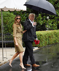 September 2, 2017 - Washington, District of Columbia, U.S. - President DONALD TRUMP and first lady MELANIA TRUMP walk Marine One departure from the White House. The President and first lady are traveling to Texas to visit individuals impacted by Hurricane Harvey. (Credit Image: © Olivier Douliery/CNP via ZUMA Wire)