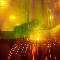 020215       Adron Gardner<br /> <br /> Sparks fly as Tiffany Shay works behind a welding curtain in the Welding Technology shop at the University of New Mexico in Gallup Monday.