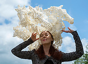 © Licensed to London News Pictures. 18/06/2014. Ascot, UK. Larisa Katz wears a hat that looks like horses.  Day two at Royal Ascot 18th June 2014. Royal Ascot has established itself as a national institution and the centrepiece of the British social calendar as well as being a stage for the best racehorses in the world. Photo credit : Stephen Simpson/LNP