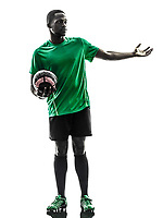one african man soccer player green jersey in silhouette on white background