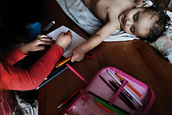 "Veronika Sindelárová's youngest child, Fabián Gina, 1, plays with the school supplies of relative Vanesa Sindelárová, 8, in their home in Ostrava, Czech Republic on Feb. 27, 2012. Veronika was one of 18 Roma children who were represented in the D.H. and Others v. Czech Republic case, the first challenge to systemic racial segregation in education to reach the European Court of Human Rights.<br /> When this case was first brought in 2000, Roma children in the Czech Republic were 27 times more likely to be placed in ""special schools,"" intended for the mentally disabled, than non-Roma children. In 2007, the Grand Chamber of the European Court of Human Rights ruled that this pattern of segregation violated nondiscrimination protections in the European Convention on Human Rights. Despite this landmark decision, little change has occurred: the ""special schools"" have been renamed but follow the same substandard curriculum and Roma continue to be assigned to these schools in disproportionate numbers. The process of integration has barely begun."