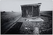Corrugated metal hut on the shingle beach at Dungeness, Kent, United Kingdom