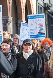 © Licensed to London News Pictures.  25/11/2017; Bristol, UK. Dame JOAN COLLINS (in peak cap) and her daughter TARA NEWLEY ARKLE (with print scarf) with women's group The Soroptomists on Bristol's College Green at a rally against domestic violence and to campaign for healthy relationships. Under the banner 'Railing Against Abuse', members of the group travelled to Bristol by train on Saturday, November 25, before walking to College Green where they handed out leaflets entitled Loves Me, Loves Me Not in the shape of bookmarks and cards which offer a simple message about abusive relationships and a helpline for anyone who needs support. They were joined by Lord Mayor Lesley Alexander, and Avon & Somerset Police and Crime Commissioner Sue Mountstevens. The march marks the United Nations' Elimination of Violence Against Women Day. Picture credit: Simon Chapman/LNP