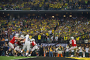 Cardale Jones #12 of the Ohio State Buckeyes throws the ball out of his own end zone against the Oregon Ducks during the College Football Playoff National Championship Game at AT&T Stadium on January 12, 2015 in Arlington, Texas.  (Cooper Neill for The New York Times)