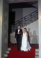 .Ed Cox and Tricia Nixon pose in the grand foyer at the wedding of Trica Nixon and Ed Cox in the White House on June 12, 1971..Photograph by Dennis Brack  BS B 15