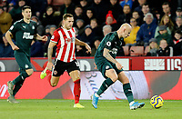 SHEFFIELD, ENGLAND - DECEMBER 05: <br /> Newcastle United's Jonjo Shelvey shields the ball from Sheffield United's Billy Sharp during the Premier League match between Sheffield United and Newcastle United at Bramall Lane on December 5, 2019 in Sheffield, United Kingdom. (Photo by Rich Linley - CameraSport via Getty Images)
