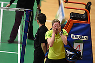 Carissa Turner of Wales reacts after she loses her Womens singles match against Linda Zetchiri . Wales international badminton championships 2014 at the Welsh institute of Sport, Sophia Gardens in Cardiff, South Wales on Friday 28th November 2014<br /> pic by Andrew Orchard, Andrew Orchard sports photography.