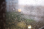 Rain on a window pane during a very wet grey and cold English winter.