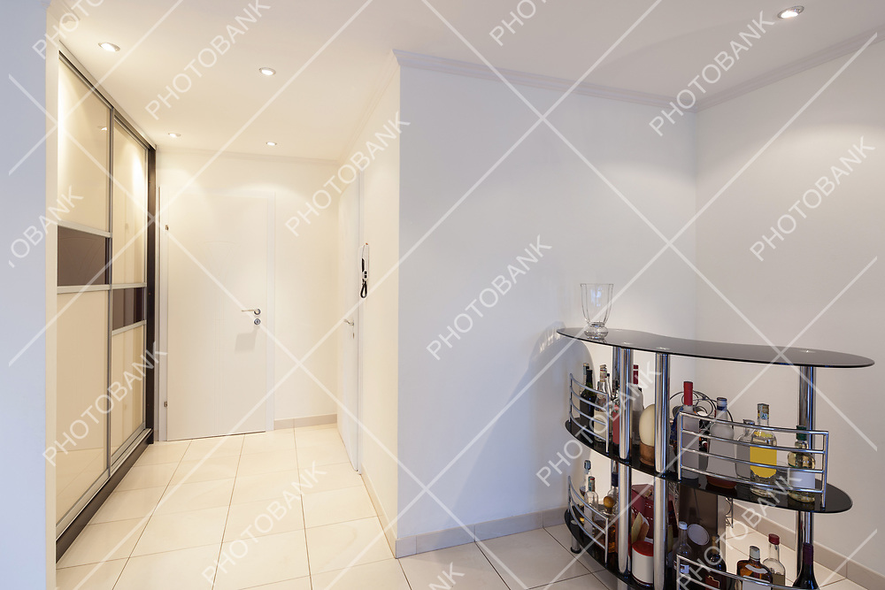 Entrance of a modern apartment, corner of the living room