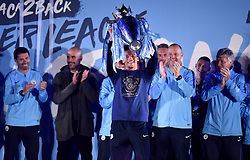 Manchester City's Leroy Sane on stage with the trophy during the celebrations at the Etihad Stadium after securing the Premier League title earlier in the day with their win at Brighton and Hove Albion.