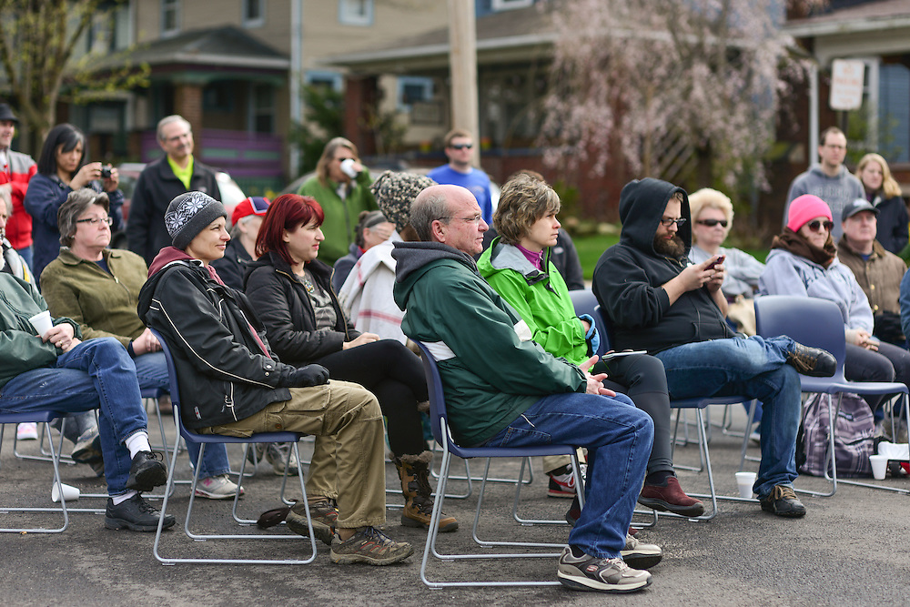 Residents listening to speakers at Block to Lock: Bike for the Earth Day.