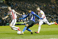 Sheffield Wednesday midfielder Rolando Aarons (39) crosses the ball during the EFL Sky Bet Championship match between Sheffield Wednesday and Sheffield United at Hillsborough, Sheffield, England on 4 March 2019.