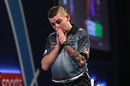 Nathan Aspinall reacts to missing a shot during the World Darts Championships 2018 at Alexandra Palace, London, United Kingdom on 28 December 2018.