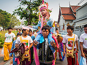 "05 APRIL 2015 - CHIANG MAI, CHIANG MAI, THAILAND: Tai Yai boys being ordained as Buddhist novices parade through the streets of Chiang Mai with their families during the second day of the three day long Poi Song Long Festival in Chiang Mai. The Poi Sang Long Festival (also called Poy Sang Long) is an ordination ceremony for Tai (also and commonly called Shan, though they prefer Tai) boys in the Shan State of Myanmar (Burma) and in Shan communities in western Thailand. Most Tai boys go into the monastery as novice monks at some point between the ages of seven and fourteen. This year seven boys were ordained at the Poi Sang Long ceremony at Wat Pa Pao in Chiang Mai. Poy Song Long is Tai (Shan) for ""Festival of the Jewel (or Crystal) Sons.    PHOTO BY JACK KURTZ"