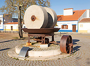 Husk mill historic olive oil press with granite millstones used until 1970s now a heritage monument to a former industrial past, village of Alvito, Beja district, Baixa Alentejo, Portugal, southern Europe